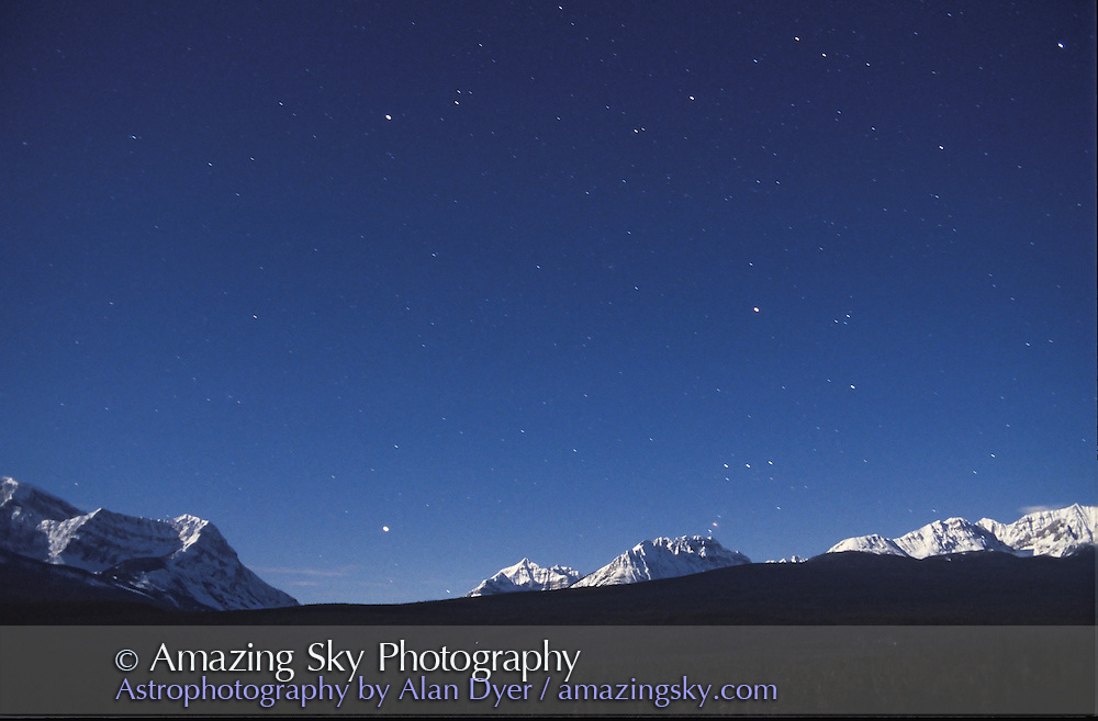 Orion setting over Storm Mountain and Vermilion Pass, from Storm Mountain Lookout, Bow Valley Parkway, Banff National Park<br /> 28mm lens at f/2.8<br /> Ektachrome 400 slide film<br /> about 30 second exposure<br /> Full Moon light, March 1995