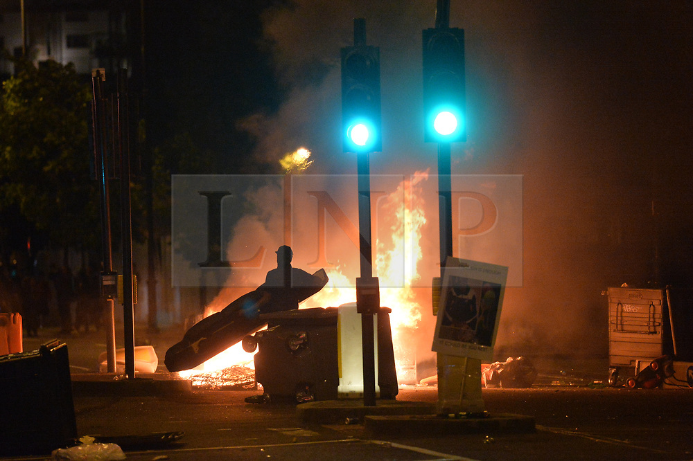 "© Licensed to London News Pictures. 28/07/2017. London, UK. Protester take to the streets of Dalston and clash with police following the death of Rashan Charles whilst being arrested by police.  A statement from Scotland Yard said Mr Charles went into a shop, where he was seen ""trying to swallow an object"" and it was then police officers struggled with him to make an arrest. Photo credit: Ray Tang/LNP"
