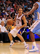 Oct. 22 2010; Phoenix, AZ, USA; Phoenix Suns point guard Steve Nash (13) handles the ball against the Denver Nuggets during a preseason game at the US Airways Center. The Nuggets defeated the Suns 144 - 106. Mandatory Credit: Jennifer Stewart-US PRESSWIRE.