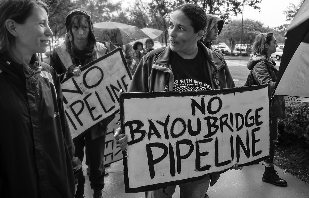 Protest against the Bayou Bridge Pipeline in New Orleans. A group gathered in the rain and marched to LDNR offices of Mr. Frank Cole to drop off a letter explaining why the permit for the pipeline should be denied.Cherri Foytlin walking into the DNR's office.