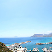 Panoramic view over Calp beach and famous Natural Park of Peñón de Ifach (Spain).