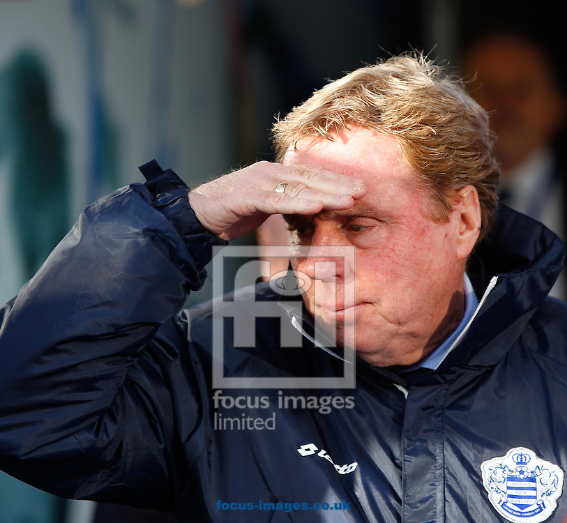 CORRECTED METADATA: QPR manager Harry Redknapp looks on during the Sky Bet Championship match at the Loftus Road Stadium, London<br /> Picture by Andrew Tobin/Focus Images Ltd +44 7710 761829<br /> 16/02/2014