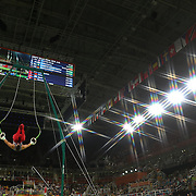 Gymnastics - Olympics: Day 3  Jacob Dalton #193 of  the United States performing his Still Rings routine during the Artistic Gymnastics Men's Team Final at the Rio Olympic Arena on August 8, 2016 in Rio de Janeiro, Brazil. (Photo by Tim Clayton/Corbis via Getty Images)<br /> <br /> (Note to editors: A special effects starburst filter was used in the creation of this image)