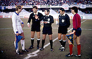 19.03.1986, Olympic Stadium, Helsinki, Finland..European Champions Cup, Quarter Final, 2nd leg match, FC Kuusysi v Steaua Bucuresti..Captains Esa Pekonen (Kuusysi - white) and Tudorel Stoica (Steaua) at the toss of coin with referee Vojtech Christov..©Juha Tamminen