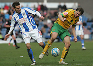 Huddersfield - Saturday, March 13th, 2010: Dean Heffernan of Huddersfield Town in action against Grant Holt of Norwich City during the Coca Cola League One match at the Galpharm Stadium, Huddersfield. (Pic by Michael Sedgwick/Focus Images)