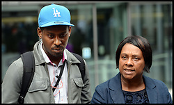 Theresa May and Doreen Lawrence Meeting.<br /> The campaigner and mother of murdered teenager Stephen Lawrence - Doreen Lawrence with son Stuart Lawrence after a private meeting with the Home Secretary Theresa May, following allegations that the Metropolitan Police engaged in a smear campaign against her and her family's supporters, at the Home Office, Thursday June 27, 2013. Photo By Andrew Parsons / i-Images