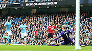 Marcus Rashford of Manchester United scores the first goal 0-1 during the Barclays Premier League match between Manchester City and Manchester United at the Etihad Stadium, Manchester, England on 20 March 2016. Photo by Phil Duncan.