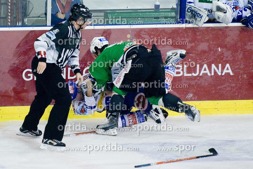 Fight between Burke Henry (HDD Tilia Olimpija, #9) and Michael Raffl (EC Rekord-Fenster VSV, #12) during ice-hockey match between HDD Tilia Olimpija and EC Rekord-Fenster VSV in 46th Round of EBEL league, on Februar 6, 2011 at Hala Tivoli, Ljubljana, Slovenia. (Photo By Matic Klansek Velej / Sportida.com)