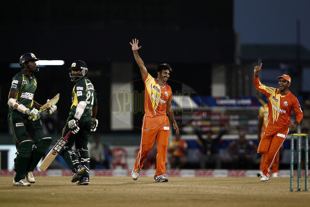 Aizaz Cheema of the LAHORE LIONS celebrates the wicket of Tillakaratne Sampath of the SOUTHERN EXPRESS during the qualifier 5 match of the Oppo Champions League Twenty20 between the Southern Express and the Lahore Lions held at the Chhattisgarh International Cricket Stadium, Raipur, India on the 16th September 2014<br /> <br /> Photo by:  Deepak Malik / Sportzpics/ CLT20<br /> <br /> <br /> Image use is subject to the terms and conditions as laid out by the BCCI/ CLT20.  The terms and conditions can be downloaded here:<br /> <br /> http://sportzpics.photoshelter.com/gallery/CLT20-Image-Terms-and-Conditions-2014/G0000IfNJn535VPU/C0000QhhKadWcjYs