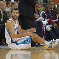 05 November 2008: New Orleans Hornets forward Peja Stojakovic (16) sits on the floor after being fouled by Atlanta Hawks forward Josh Smith (not pictured) during the first half of a NBA game between the New Orleans Hornets and the Atlanta Hawks at the New Orleans Arena in New Orleans, LA..