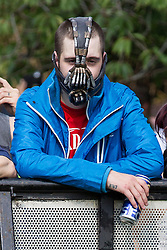 "© Licensed to London News Pictures . 26/08/2013 . Bolton , UK . An English Defence League protester wearing a "" Bane "" facemask at the demonstration The English Defence League hold a demonstration in Farnworth Park , Bolton , today (26th August 2013) . Photo credit : Joel Goodman/LNP"