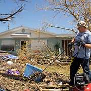 MARATHON, FL - SEPTEMBER 16: <br /> Tim Thompson, Minister of the Marathon Church of Christ,  clears debris in front of the house he rents next to his church after arriving from Homestead where he and his wife Kathy evacuated to before Hurricane Irma made landfall. They rent a house next to the church on September 16, 2017 in Marathon, Florida.  (Photo by Angel Valentin/Getty Images)
