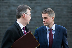 © Licensed to London News Pictures. 19/12/2017. London, UK. Attorney General Jeremy Wright (L) and Defence Secretary Gavin Williamson (R) speak on Downing Street after the weekly Cabinet meeting. Photo credit: Rob Pinney/LNP