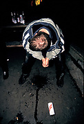 A clubber throws up, U.K, 1990s.