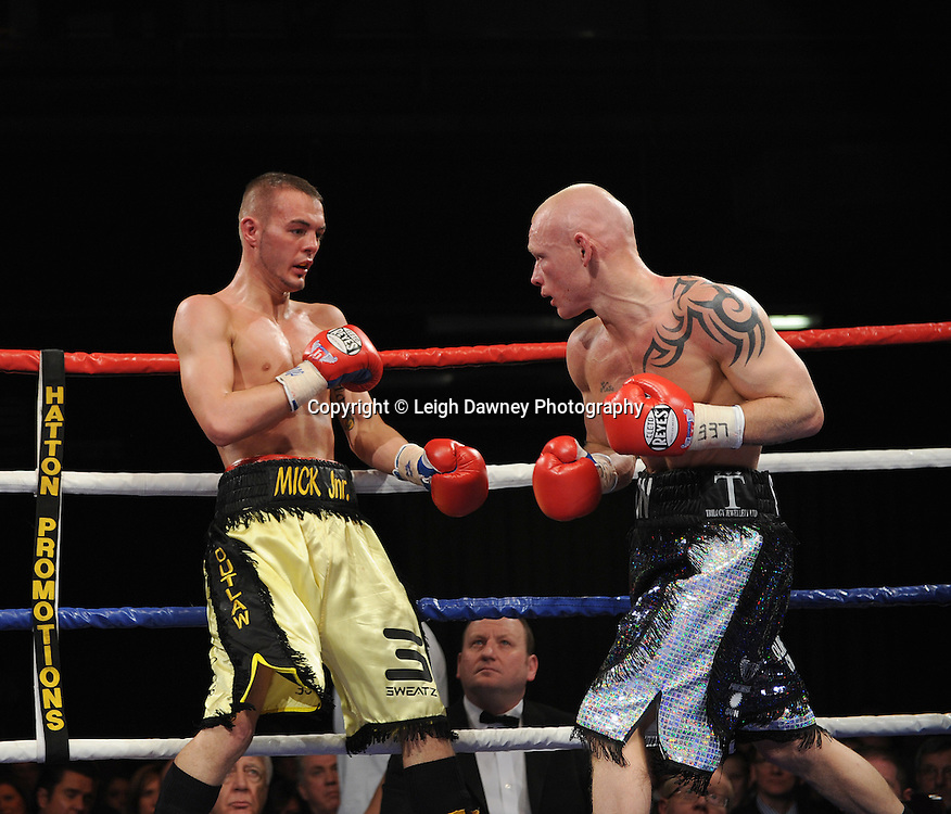 Craig Lyon (black/silver shorts) v Josh Wale. Fight stopped after both boxers have cuts above the left eyes following an accidental clash of heads. Premier Suite, Reebok Stadium, Bolton on Saturday 26th February 2011. Hatton Promotions. Photo credit © Leigh Dawney.