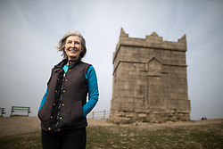 © Licensed to London News Pictures . 18/04/2019. Bolton , UK . Leader of Horwich and Blackrod First Independents MARIE BRADY (58) , from Horwich , in front of Rivington Pike on Winter Hill . Independent political parties , not tied to existing national parties , are competing for council seats in wards across the North West . Photo credit : Joel Goodman/LNP