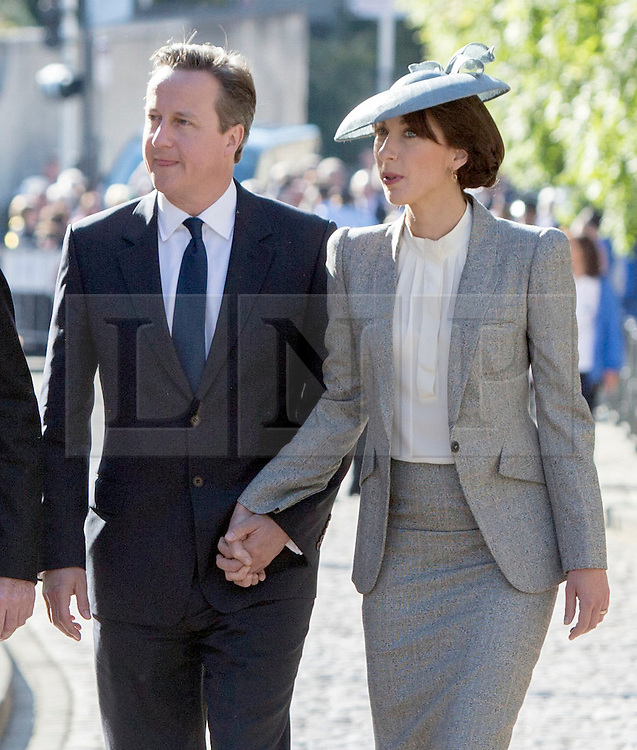 © Licensed to London News Pictures. 06/06/2014. Bayeux, Normandy.  David Cameron and Samantha Cameron join veterans and their guests at the Royal British Legions 70th Anniversary service of the D Day landings in the cathedral at Bayeux this morning.  The majority of the 600 veterans attended the service along with HRH The Queen and Prince Phillip.  Bayeux, Normandy.  Bayeux, Normandy. Photo credit : Alison Baskerville/LNP