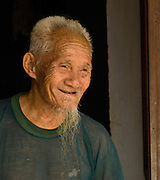 Old man in Thanh Ha Village, near Hoi An, Central Vietnam,