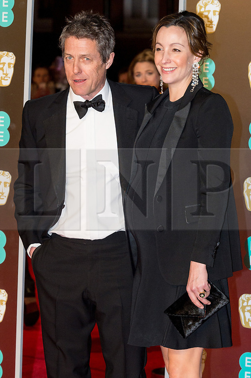 © Licensed to London News Pictures. 18/02/2018. HUGH GRANT and ANNA EBERSTEIN arrives on the red carpet for the EE British Academy Film Awards 2018, held at the Royal Albert Hall, London, UK. Photo credit: Ray Tang/LNP
