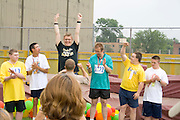 Victory for winning athlete at award ceremony. Special Olympics U of M Bierman Athletic Complex. Minneapolis Minnesota USA