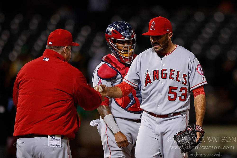 OAKLAND, CA - APRIL 04:  Blake Parker #53 of the Los Angeles Angels of Anaheim is relieved by manager Mike Scioscia #14 during the seventh inning against the Oakland Athletics at the Oakland Coliseum on April 4, 2017 in Oakland, California. The Los Angeles Angels of Anaheim defeated the Oakland Athletics 7-6. (Photo by Jason O. Watson/Getty Images) *** Local Caption *** Blake Parker; Mike Scioscia