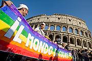 2013/06/15 Roma, corteo del Gay Pride 2013. Nella foto alcuni manifestanti.<br /> Rome, Gay Pride rally 2013. In the picture protester hold banner reading ' world is in color ' - &copy; PIERPAOLO SCAVUZZO