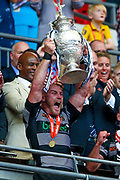 Hull FC loose forward and captain Gareth Ellis (13) lifts the challenge cup for the victorious Hull FC side during the Ladbrokes Challenge Cup Final 2017 match between Hull RFC and Wigan Warriors at Wembley Stadium, London, England on 26 August 2017. Photo by Simon Davies.