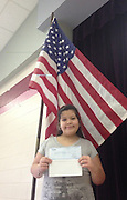Lyons ES student Samantha Torres with her donation check.