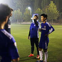 BEIJING, OCT.18, 2014 : Song Yonglin, 14, talks with his team laeder during a short break. He spends every weekend taking extra school lessons in order to improve his scores which cost his parents about 4-5000 Yuan/month. He would like to switch to the International school in Beijing  and study economics later on in the US.