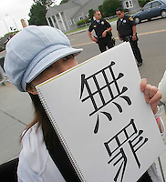 "A Michael Jackson fan from Japan displays a sign the reads ""innocent"" outside the courthouse where his trial is taking place in Santa Maria, California June 3, 2005. The closing arguments in the Jackson sexual abuse case were expected to conclude today."
