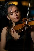 Olga Piddubna performing on violin.