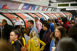 © Licensed to London News Pictures. 05/08/2015. London, UK. Commuters queuing for tube trains at Oxford Circus tube station ahead of the Tube strike in the evening rush hour of Wednesday, August 5, 2015. The strike will be a 27-hour stoppage by about 20,000 Tube staff to shut down the entire London Underground network on the second strike over night `service on parts of Tube, which will be starting on 12 September 2015. Photo credit: Tolga Akmen/LNP