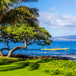 Wailea Makena Maui Hawaii panorama photo with a palm tree, outrigger canoe and <br /> Kaho'olawe Island along the Pacific Ocean. Copyright ⓒ 2019 Paul Velgos with All Rights Reserved.