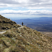 Walkers on the Tangariro Alpine Crossing.  The Tongariro Alpine Crossing is a 7-8 hour hike traversing two active volcanoes within the Tongariro National Park, North Island, New Zealand.  It is considered to be the best one day hike in New Zealand and in the top 10 one day hikes in the world. Packed into the 19.4km hike is an array of diverse landscapes and vegetations. From tussock like alpine meadows, to rugged lava flows, desert like craters and emerald lakes.  The Tongariro Alpine  9th January 2011. Photo Tim Clayton..