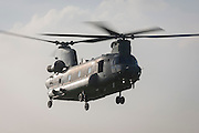 A Chinook helicopter hovering in mid-air.