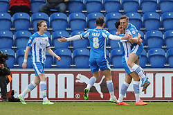 Colchester United's Tom Lapslie celebrates with his team mates after scoring. - Photo mandatory by-line: Dougie Allward/JMP - Mobile: 07966 386802 - 21/02/2015 - SPORT - Football - Colchester - Colchester Community Stadium - Colchester United v Bristol City - Sky Bet League One