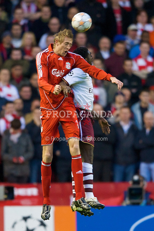 LIVERPOOL, ENGLAND - Tuesday, April 8, 2008: Liverpool's Peter Crouch wins a header against Arsenal's Kolo Toure during the UEFA Champions League Quarter-Final 2nd Leg match at Anfield. (Photo by David Rawcliffe/Propaganda)