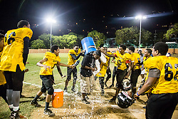 Sharks coach Deshaun Christian gets doused with ice water after his team takes home the championship.  Avengerz vs. Sharks .  Lionel Roberts Stadium.  St. Thomas, VI.  15 August 2015.  © Aisha-Zakiya Boyd