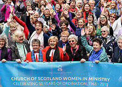 Pictured: Women ministers and supporters march into the quad of the General Assembly, led by former Moderator the Reverend Lorna Hood, where they are joined by the Moderator the Right Reverend Susan Brown.<br /> <br /> Women ministers and supporters processed up the Mound in Edinburgh to the General Assembly of the Church of Scotland to mark 50 years since the Church allowed the ordination of women.<br /> <br /> &copy; Dave Johnston / EEm