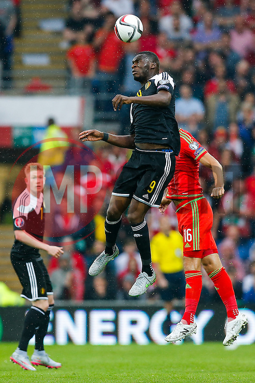Christian Benteke of Belgium (Aston Villa) and Joe Ledley of Wales (Crystal Palace) compete in the air - Photo mandatory by-line: Rogan Thomson/JMP - 07966 386802 - 12/06/2015 - SPORT - FOOTBALL - Cardiff, Wales - Cardiff City Stadium - Wales v Belgium - EURO 2016 Qualifier.