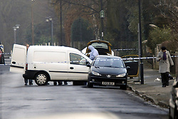 © under license to London News Pictures. 2010.12.13. Forensic police inspect a yellow car with smashed windows. A Man has been shot during a planned police operation in Eltham. Police attended Boots in Eltham High Street at 7am this morning (December 13) as part of a pre planned armed operation. During the operation a police firearm was discharged and a man received a gunshot wound. He was taken to hospital and his injuries are not thought to be life threatening. The man along with four others has been arrested. The bus stop in front of Boots is cornered off by police tape and a window of the store is cracked. Picture credit should read Grant Falvey/London News Pictures...