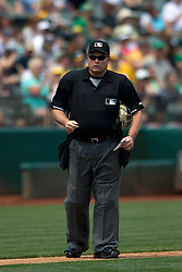 OAKLAND, CA - JULY 23:  MLB umpire Marvin Hudson #51 stands on the field during the fourth inning between the Oakland Athletics and the Toronto Blue Jays at O.co Coliseum on July 23, 2015 in Oakland, California. The Toronto Blue Jays defeated the Oakland Athletics 5-2. (Photo by Jason O. Watson/Getty Images) *** Local Caption *** Marvin Hudson
