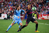 July 13 2017: Arsenal player Cohen Bramall (40) battles for the ball with Sydney FC midfielder Joshua BRILLANTE (6) at the International soccer match between English Premier League giants Arsenal and A-League premiers Sydney FC at ANZ Stadium in Sydney.