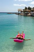 Man on pink raft, Curacao, Netherlands Antilles