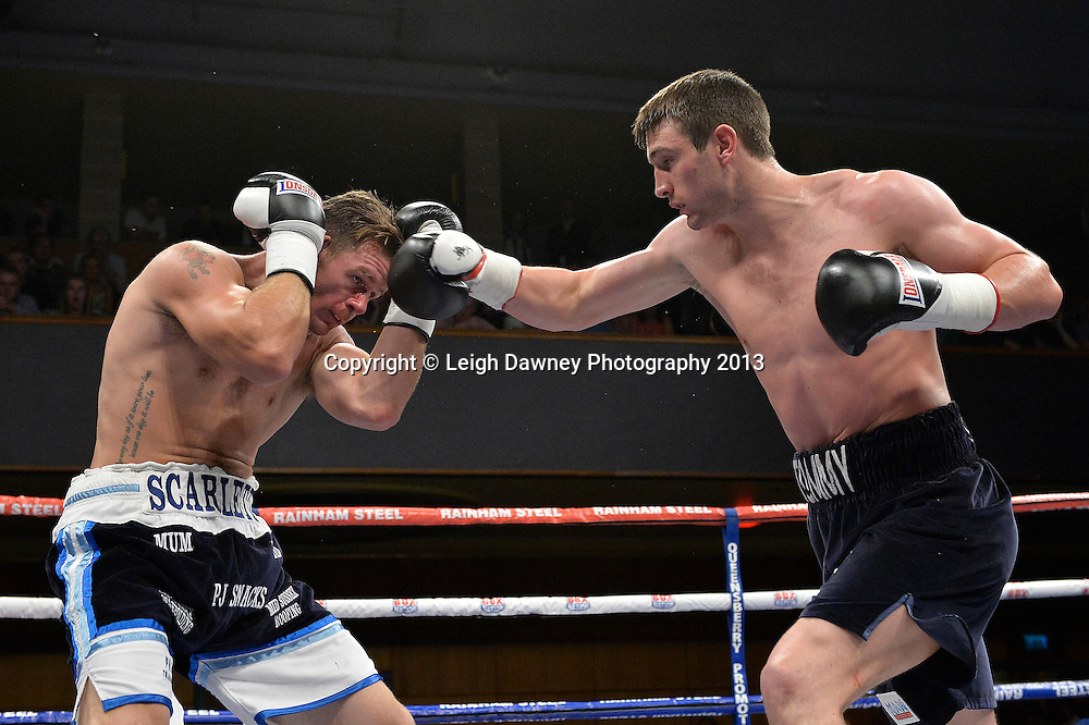 Tommy Langford (black shorts) defeats Nick Jenman in a Super Middleweight contest at Wolverhampton Civic Hall, Wolverhampton, 1st August 2014. Frank Warren in association with PJ Promotions.  © Credit: Leigh Dawney Photography.