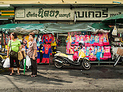 23 DECEMBER 2015 - BANGKOK, THAILAND: Women wait for a taxi in Banglamphu Market. Banglamphu Market (also spelled Bang Lamphu) is close to Bangkok's backpacker haunts of Khao San Road. The market is a popular place for knock off designer clothes and street food. The market is an informal collection of street stalls and sidewalk vendors. Bangkok city officials have plans to evict the vendors, close the market and gentrify the neighborhood. This would follow closing similar markets on Maharat Road and Saphan Lek.       PHOTO BY JACK KURTZ