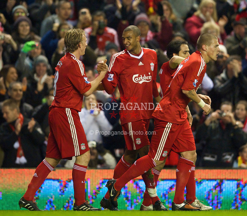 LIVERPOOL, ENGLAND - Wednesday, December 16, 2009: Liverpool's David Ngog celebrates scoring the opening goal against Wigan Athletic during the Premiership match at Anfield. (Photo by: David Rawcliffe/Propaganda)