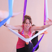 Harmony Hitchner  participates in an Aerial Yoga class at Salty Dog Yoga Sunday April 6, 2014 in Carolina Beach, N.C. (Jason A. Frizzelle)