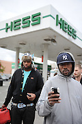 Jason Taylor of Clinton Hill (right), Drew Logan of East New York (left) and Michael Graziano of Union Beach (background) wait in line for gas at the Hess Station in Park Slope, Brooklyn during a fuel shortage following Hurricane Sandy on Nov. 2, 2012. Taylor said a man paid him fifty dollars for the three gallons of gas he had waited in line for the night before.