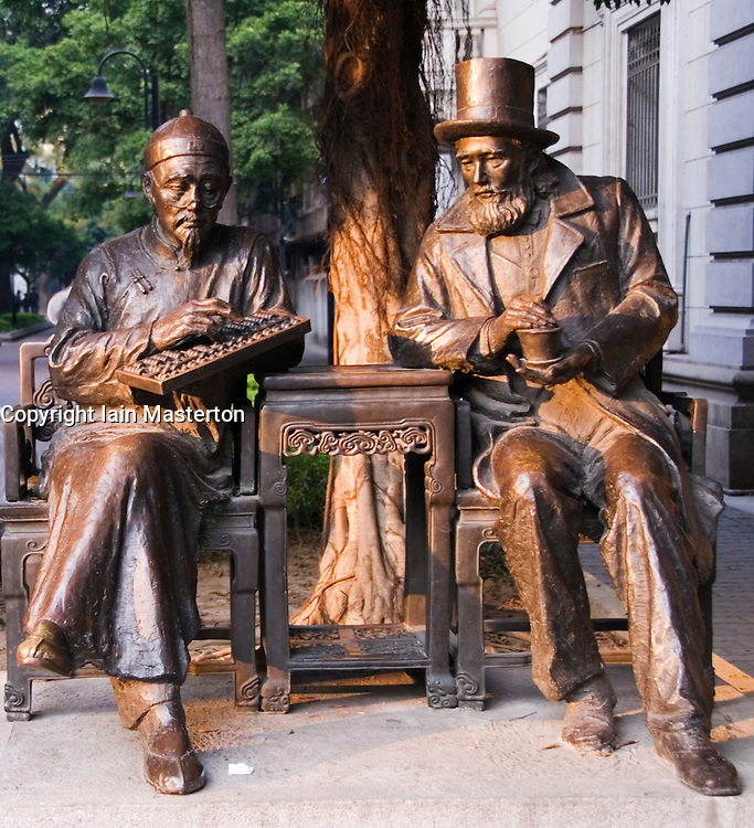 Bronze sculptures of historic traders in former foreign district of  Shamian Island area of Guangzhou in China